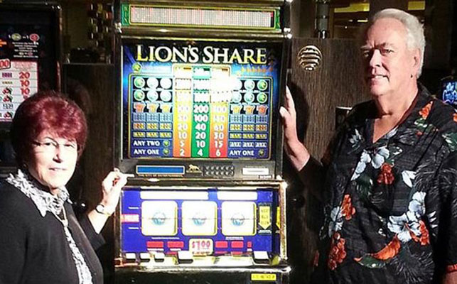 Walter and Linda Misco pose with the Lion's Share.