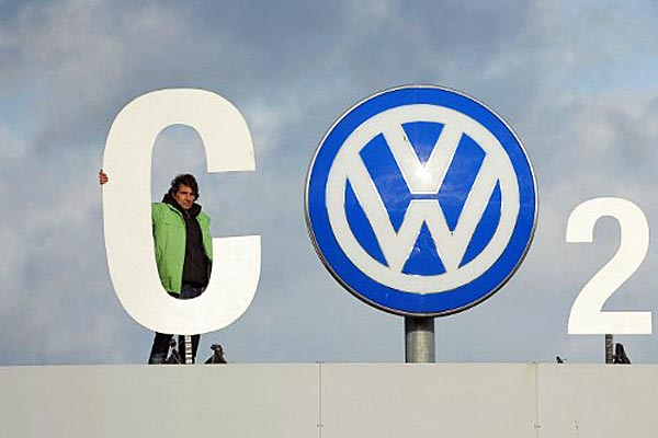 Greenpeace activists stand with 'CO2' formed with the VW logo above the Volkswagen factory gate in Wolfsburg, Germany. (AFP)