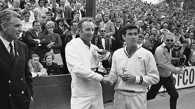 Ken Rosewall, right, congratulates Rod Laver, left, at the French open in Paris, June 7, 1969. Laver defeated Rosewell in three sets. (AAP)