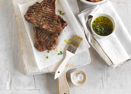 Char-grilled beef T-bone with crushed tomato and bread salad