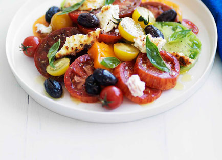 Heirloom tomato salad with baked ricotta and olives