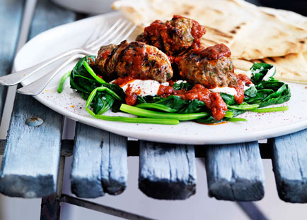 Grilled kofte with flatbread, spinach, yoghurt and spicy tomato sauce