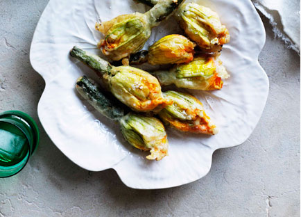 Zucchini flowers with ricotta, parmesan, and mint and anchovy sauce