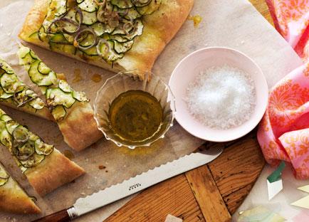 Zucchini schiacciata with green garlic oil
