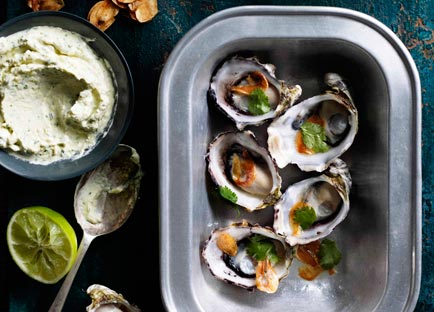 Grilled oysters with lemongrass crème fraîche, fried garlic and lime
