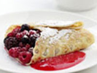 Berry-filled crepes with raspberry coulis