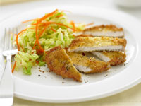 Crumbed pork with cabbage salad