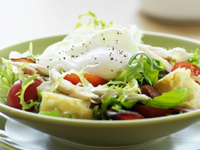 Chicken, bacon and curly endive salad with croutons