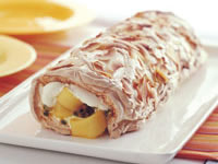 Mango passionfruit pavlova roll