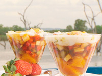 Fruit salad with sugar cane syrup and coconut cream