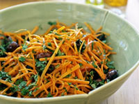 Carrot salad with olives, honey and cumin