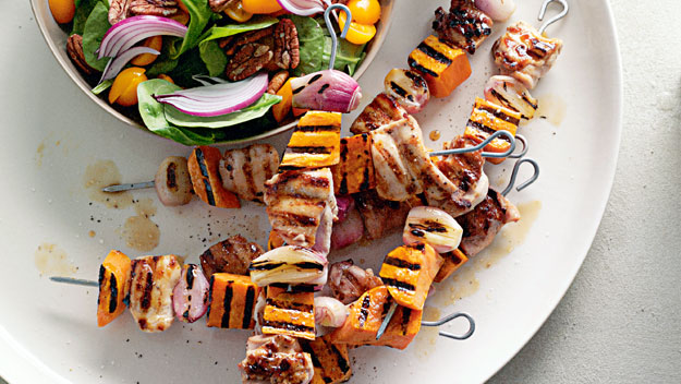 Maple-glazed chicken and kumara skewers with spinach pecan salad