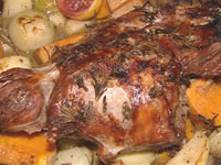Rosemary, garlic and , lemon lamb roast in the camp oven with johnny cakes