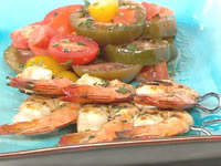 Lemon thyme prawn skewers with tomato salad