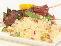 Barbecued beef kebabs with couscous salad