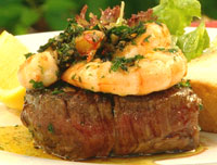 Beef fillet with garlic and herb prawns