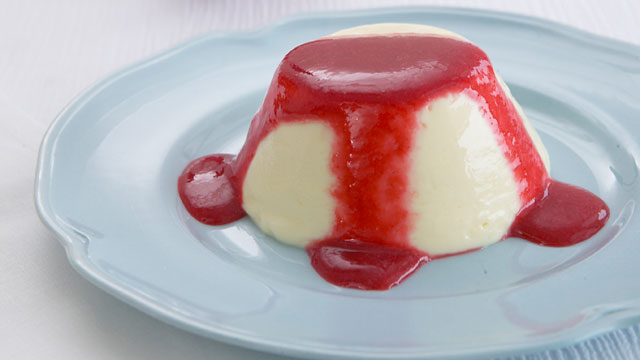 White chocolate pannacotta with raspberry coulis