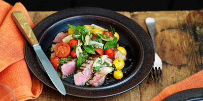 Steak with warm shallot dressing & sautéed cherry tomatoes