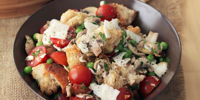 Bread salad with tomato, peas, mushrooms & pecorino