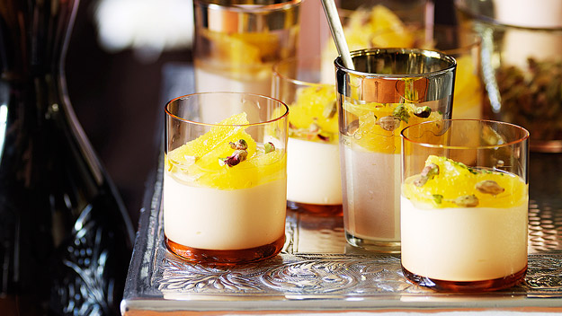 Honey and cardamom panna cotta with oranges