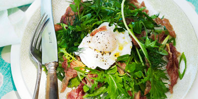 Watercress salad with herbs, crisp prosciutto & poached egg