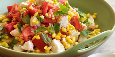 Lobster salad with potatoes, corn & tomato
