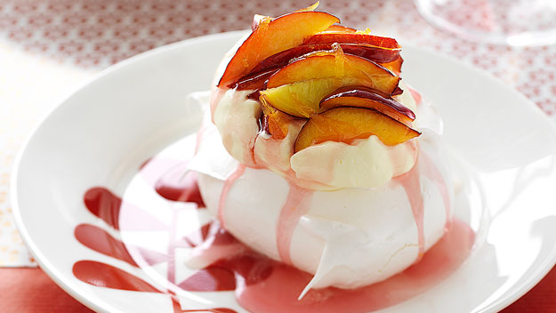 Mini pavlovas with nectarine syrup