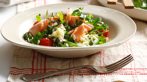 Poached salmon with asparagus, rocket and risoni salad