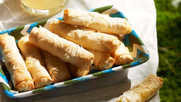 Crisp fetta, lemon & parsley filo rolls with yoghurt & dill dip