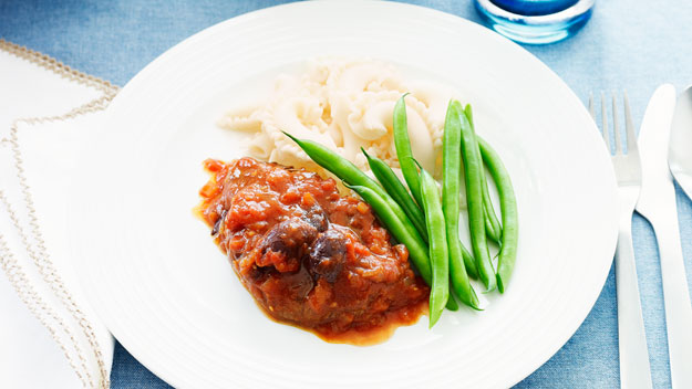 Lamb leg steak with tomato and olives