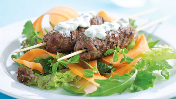 Beef skewers and carrot salad