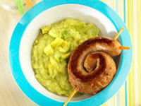 Sausage snakes on avocado-potato mash