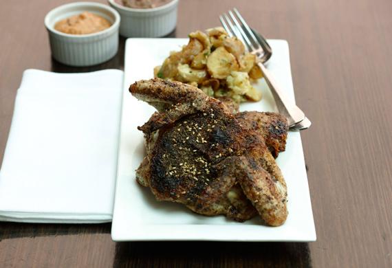 Za'atar-roasted whole baby chicken with lemon and garlic baked potatoes