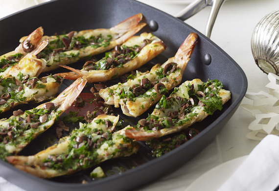 Grilled split prawns with parsley, lemon and olive salsa