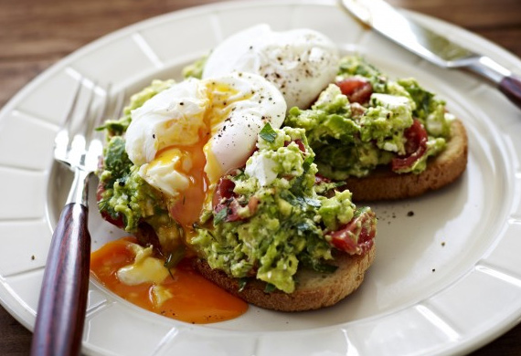 Poached eggs with avocado and feta smash on sourdough