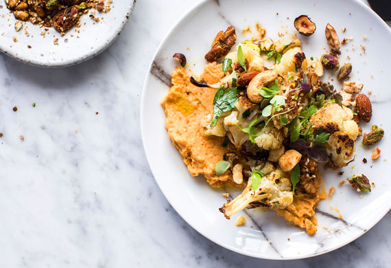 Autumn salad of roast cauliflower, sweet potato hummus and spice nut crumble
