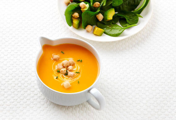 Roasted pumpkin soup with avocado and spinach salad