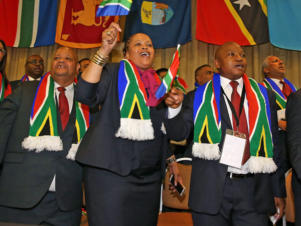 Dignatories from South Africa celebrate Durban's winning Commonwealth Games bid. (Getty)