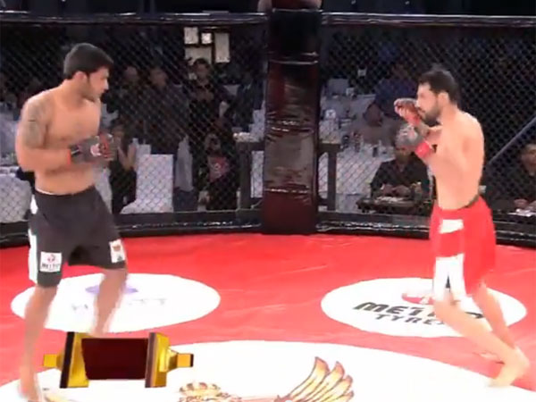 Indian MMA fighter Amitesh Chaubey unleasehes a short right to floor Jason Solomon. (Supplied)