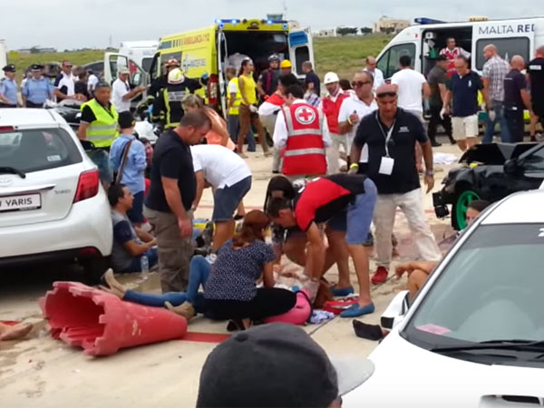 Victims are treated after the crash in Malta. (Supplied)
