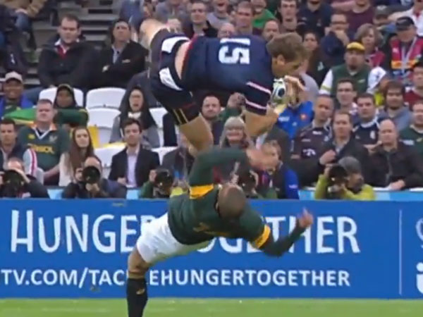 South African winger Bryan Habana and US fullback Blaine Scully collide contesting a high kick. (Supplied)
