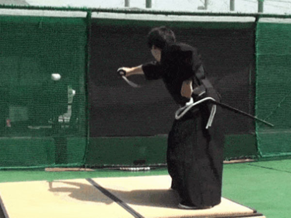 Japanaese swod master Isao Machii slices a baseball in half at 160kmh. (Supplied)
