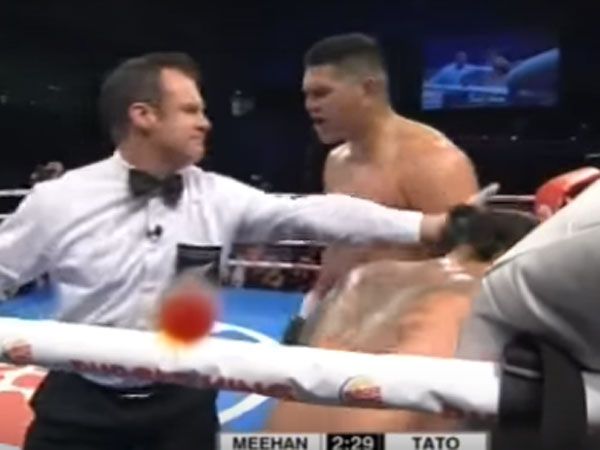 Willis Meehan pleads with the referee to stop his fight with Leamy Tato. (Supplied)