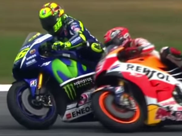 Valentino Rossi (L) battles with Marc Marquez. (Supplied)