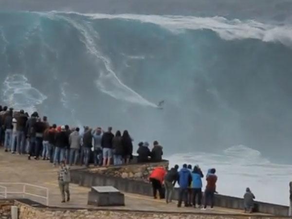 German daredevil Sebastian Steudtner rides a 60 foot wave in Portugal. (Supplied)