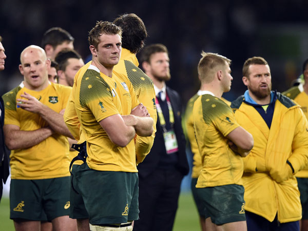 The Wallabies react to the loss against the All Blacks. (AFP)