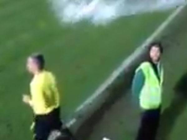 A linesman, moments before getting drenched by fans. (Supplied)