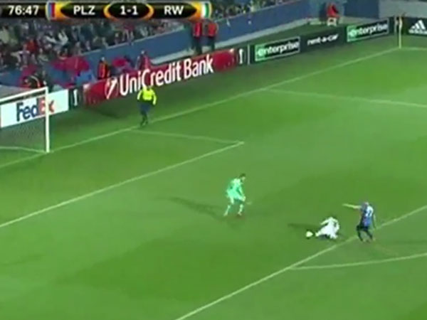Austrian footballer Phillip Schobesberger slips over before scoring a miraculous goal in the Europa League. (Supplied)