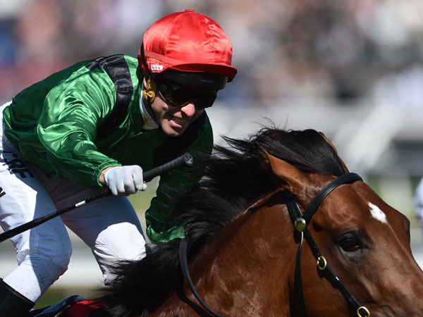 Kerrin McEvoy reacts after riding the Murray Baker Turn Me Loose to victory in in the Emirates Stakes. (AAP)