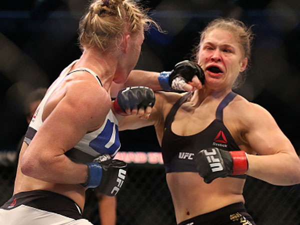 Holly Holm lands a punch on Ronda Rousey. (Getty)